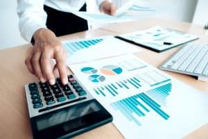 Finances Saving Economy concept. Female accountant or banker use