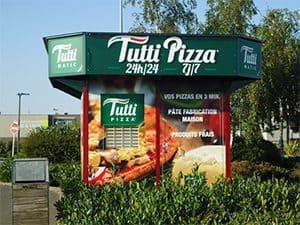 Distributeur automatique de pizzas en franchise à l'enseigne Tutti Pizza