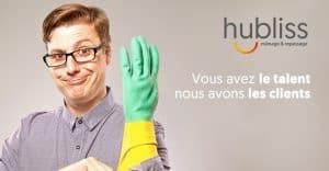 Man wearing black glasses pulling on rubber glove